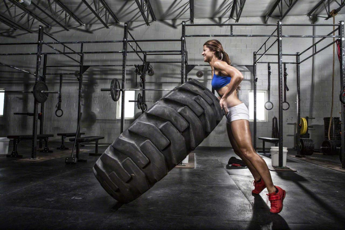CrossFit athlete flipping a tire